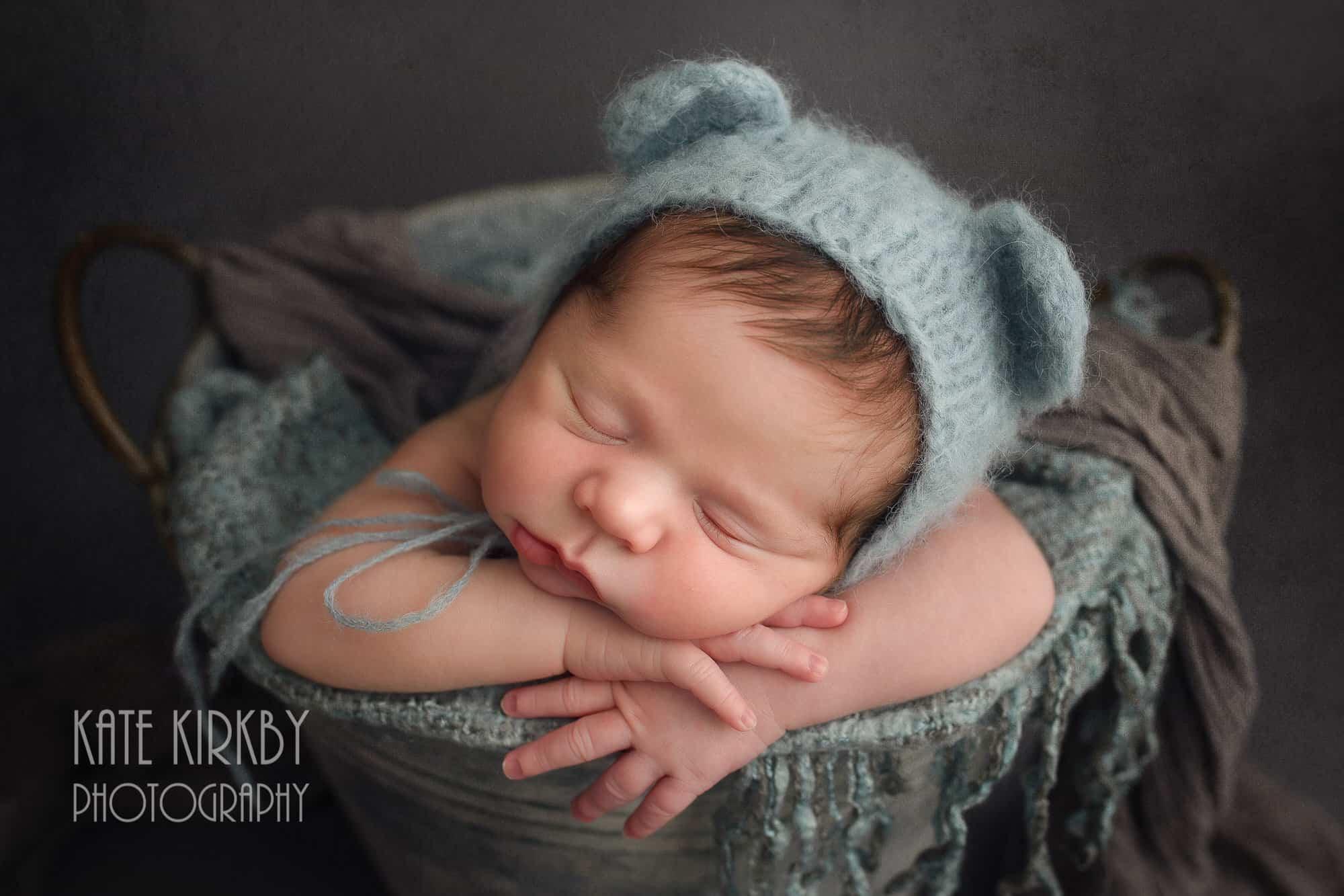 newborn is blue teddy hat