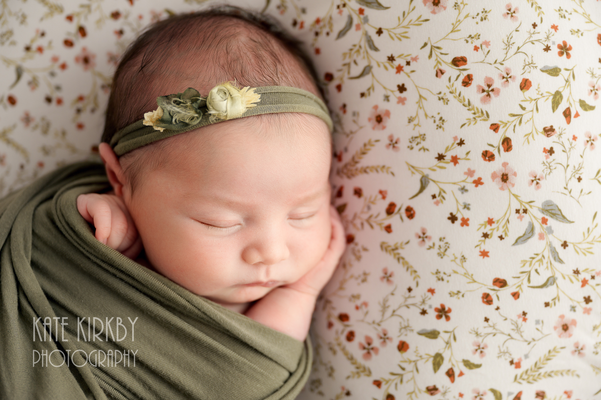 baby girl in green with flowers