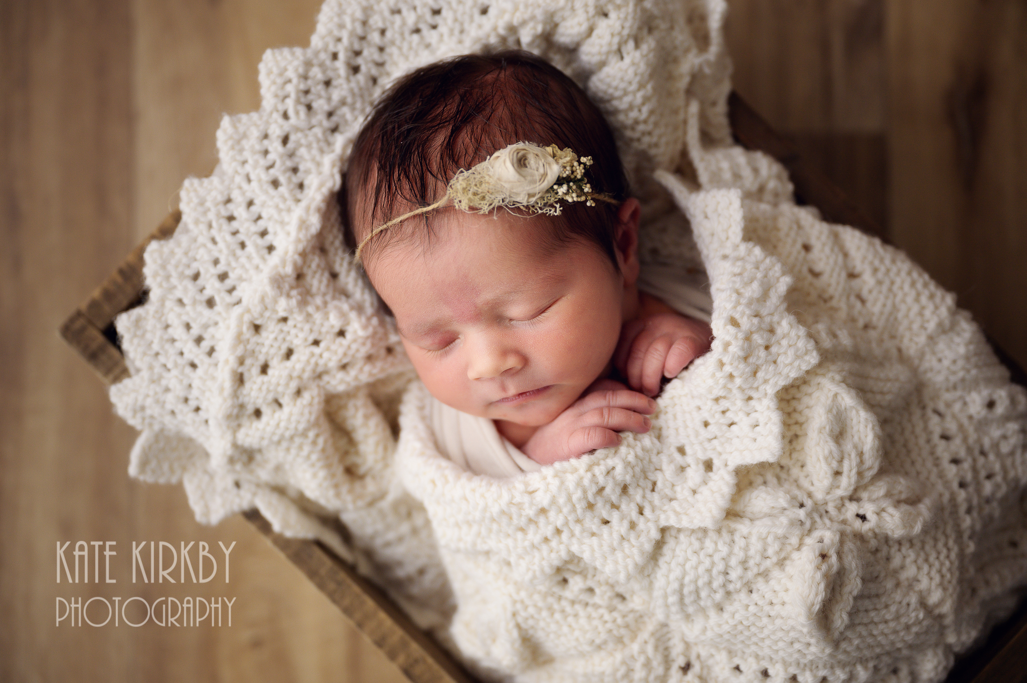 pretty baby on crocheted blanket
